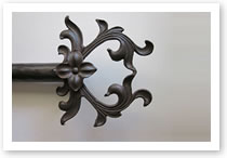 Custom iron finial, Catalog number 109, Length 6 3/4in. Height 8in.